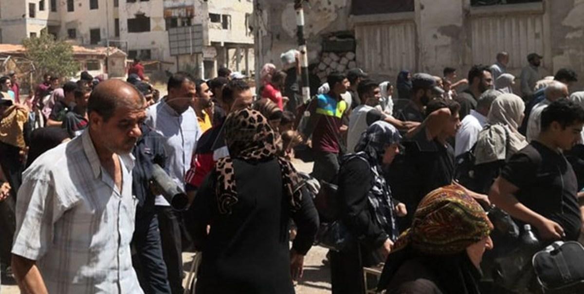 بازگشت هزاران نفر از شهروندان سوری به منازل خود در درعا البلد+تصاویر